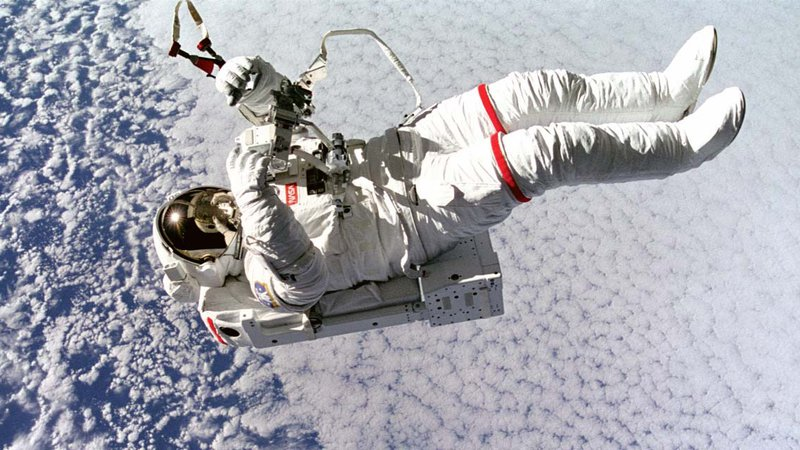 Astronaut on a space-walk above planet Earth