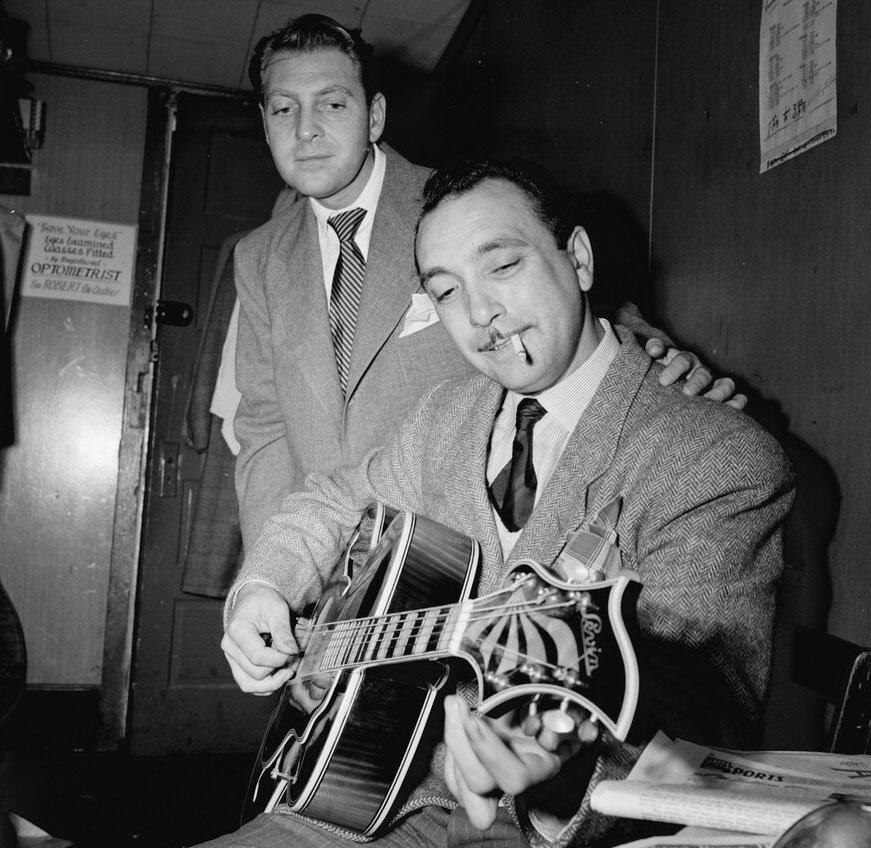 Photo of Django Reinhardt playing a guitar