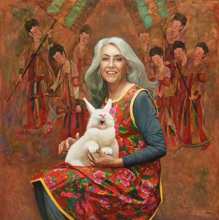 Portrait of a woman holding holding a white rabbit on her lap