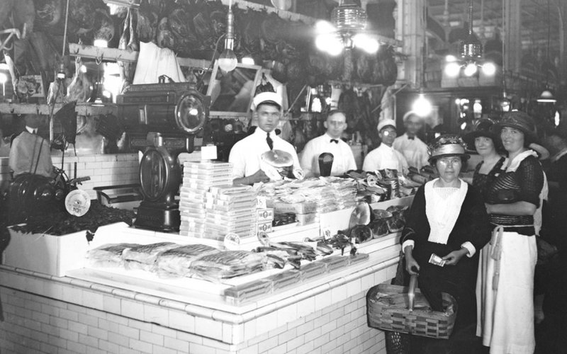 Interior photo of a delicatessen from around the turn of the 19th century
