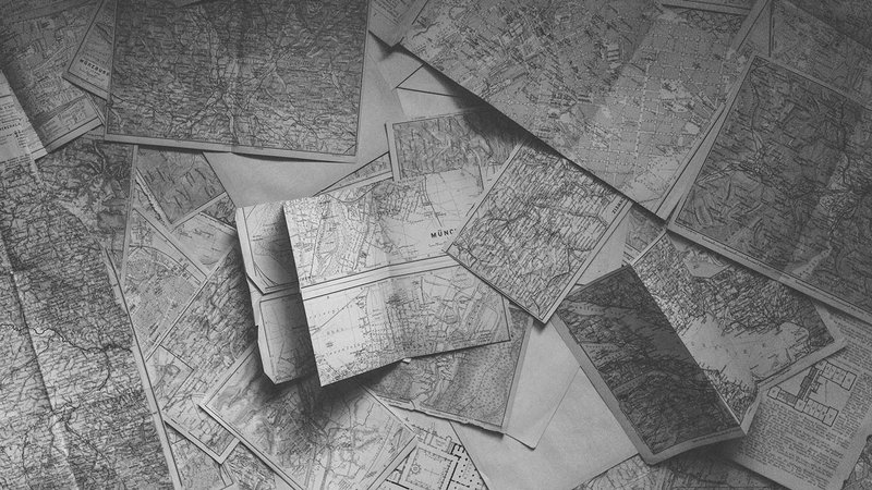Retro road maps spread out on the floor