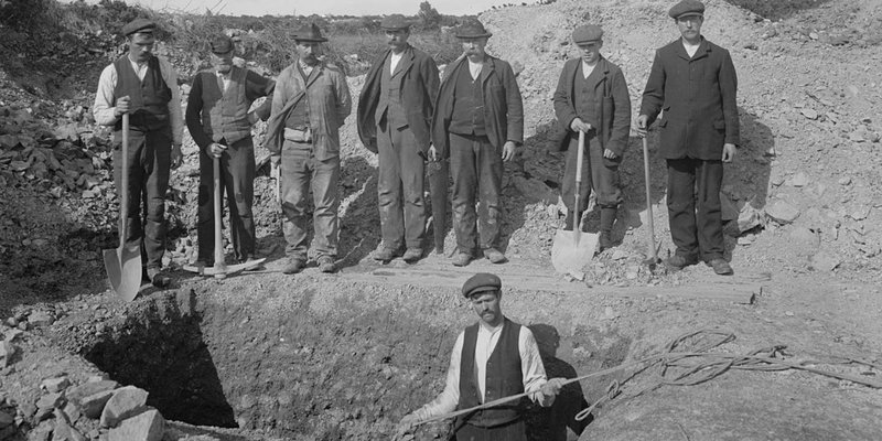 Group of men digging a hole