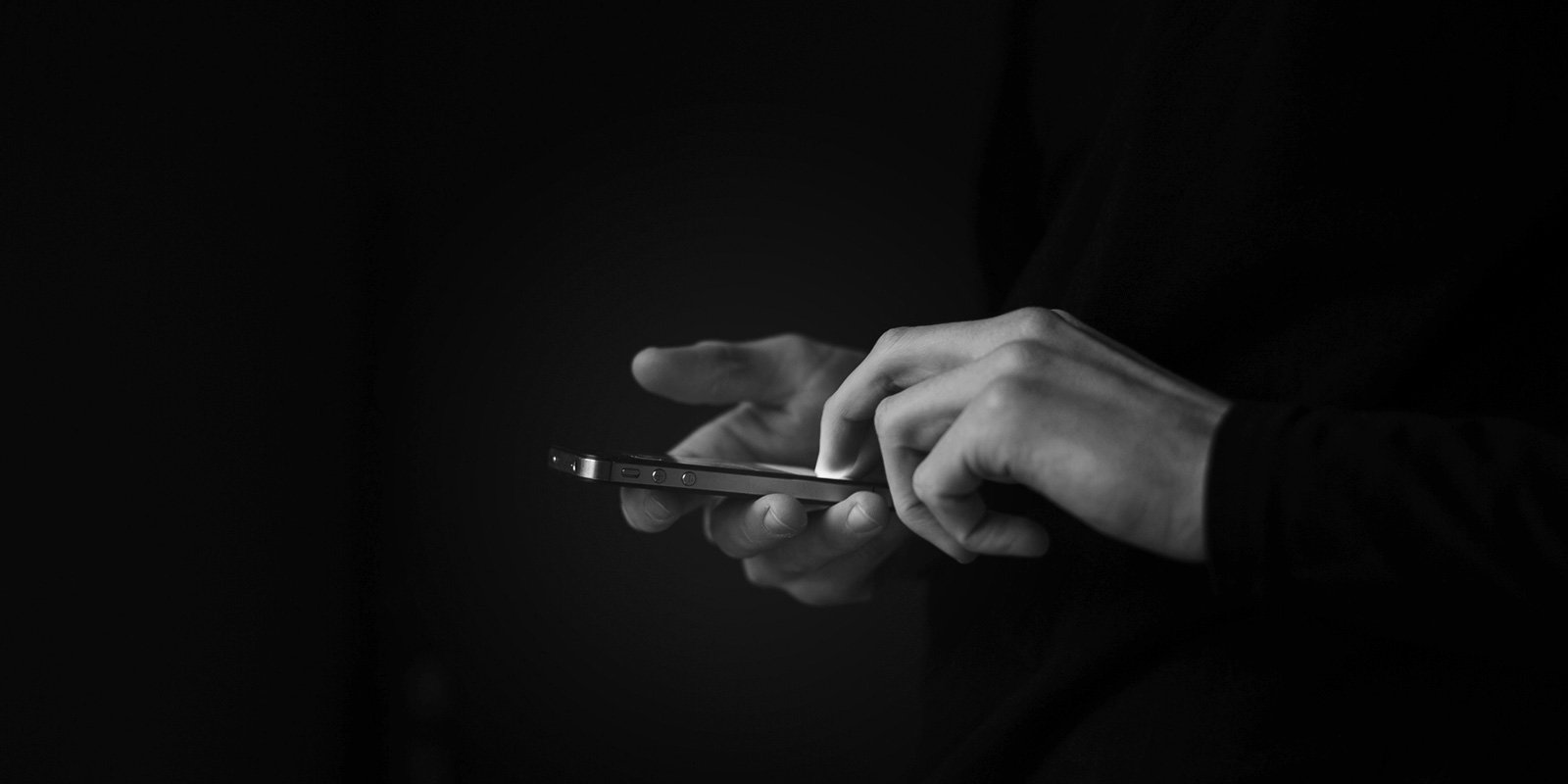 Close up photo of a pair of hands using a smartphone